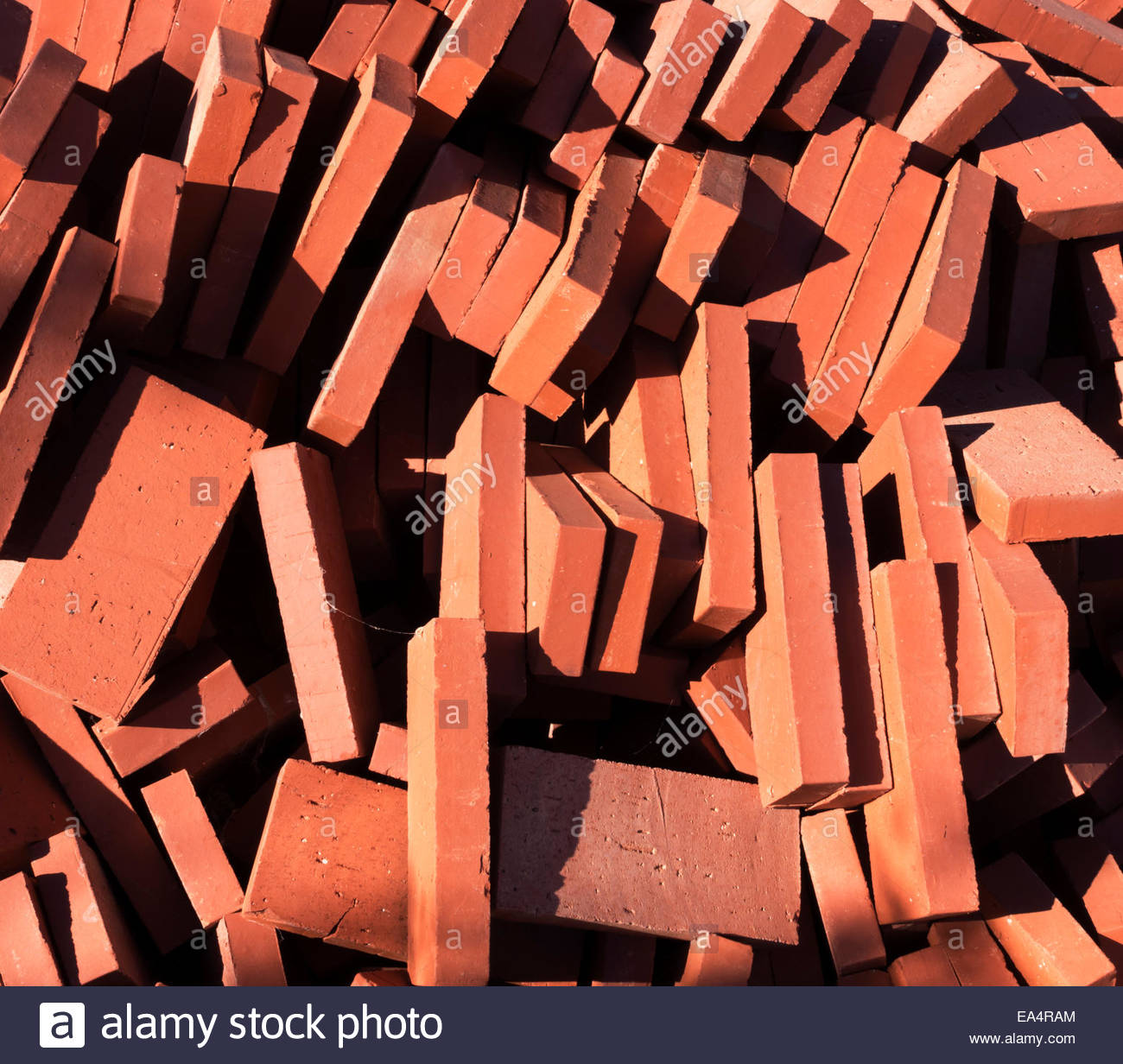 Pile of stacked red bricks - Stock Image