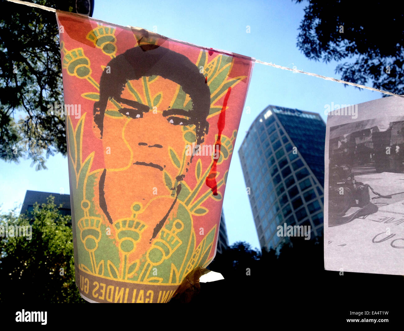 Mexico city, Mexico. 6th November, 2014. An art work displaying the face of a missing student is displayed in Reforma Stock Photo