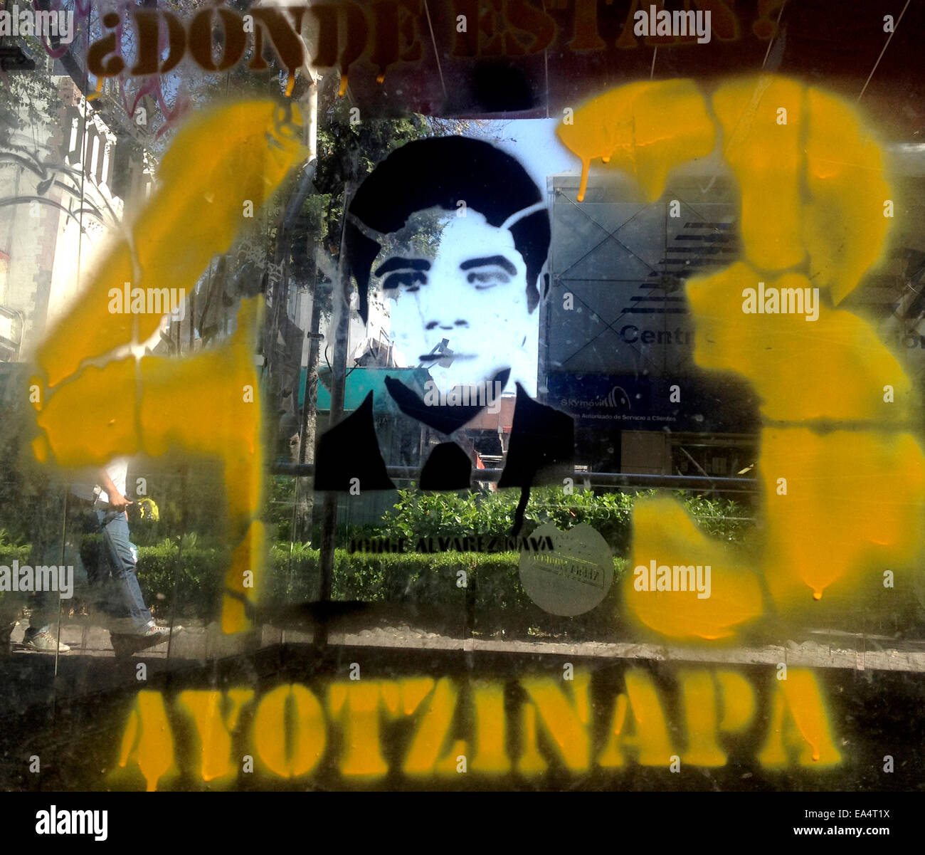 Mexico city, Mexico. 6th November, 2014. A graffiti with the face of a missing student is displayed in Reforma Avenue Stock Photo