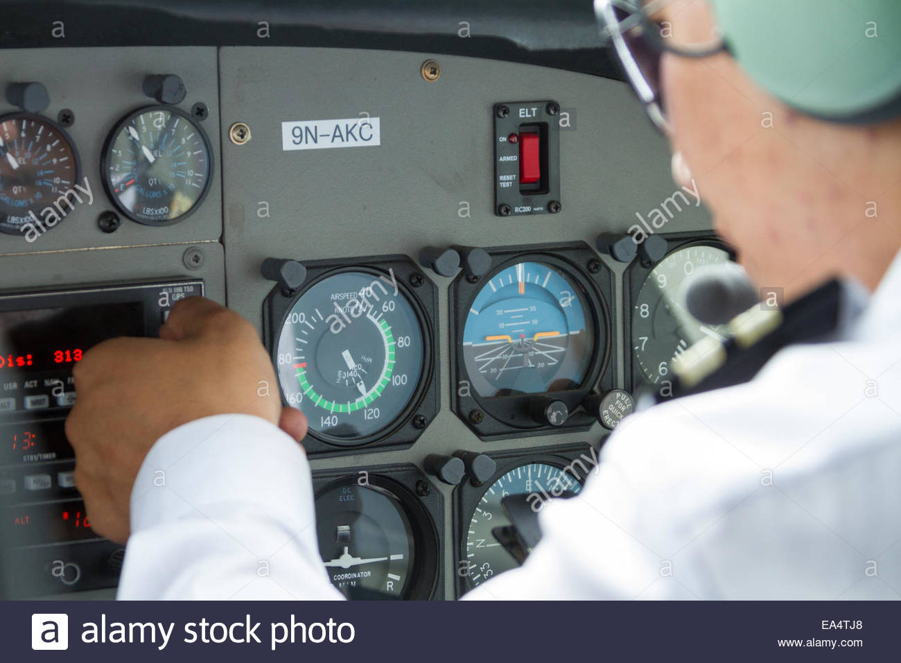 Pilot adjusting controls in cockpit of airplane - Nepal - Stock Image