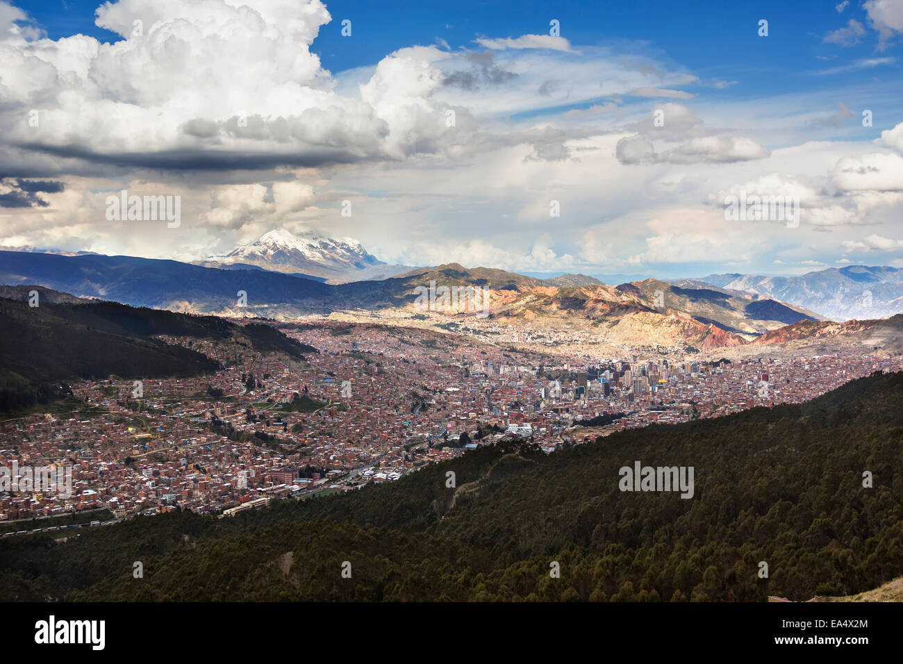 The city of La Paz with Illimani rising in the distance, the highest peak in Bolivia; La Paz, Bolivia - Stock Image