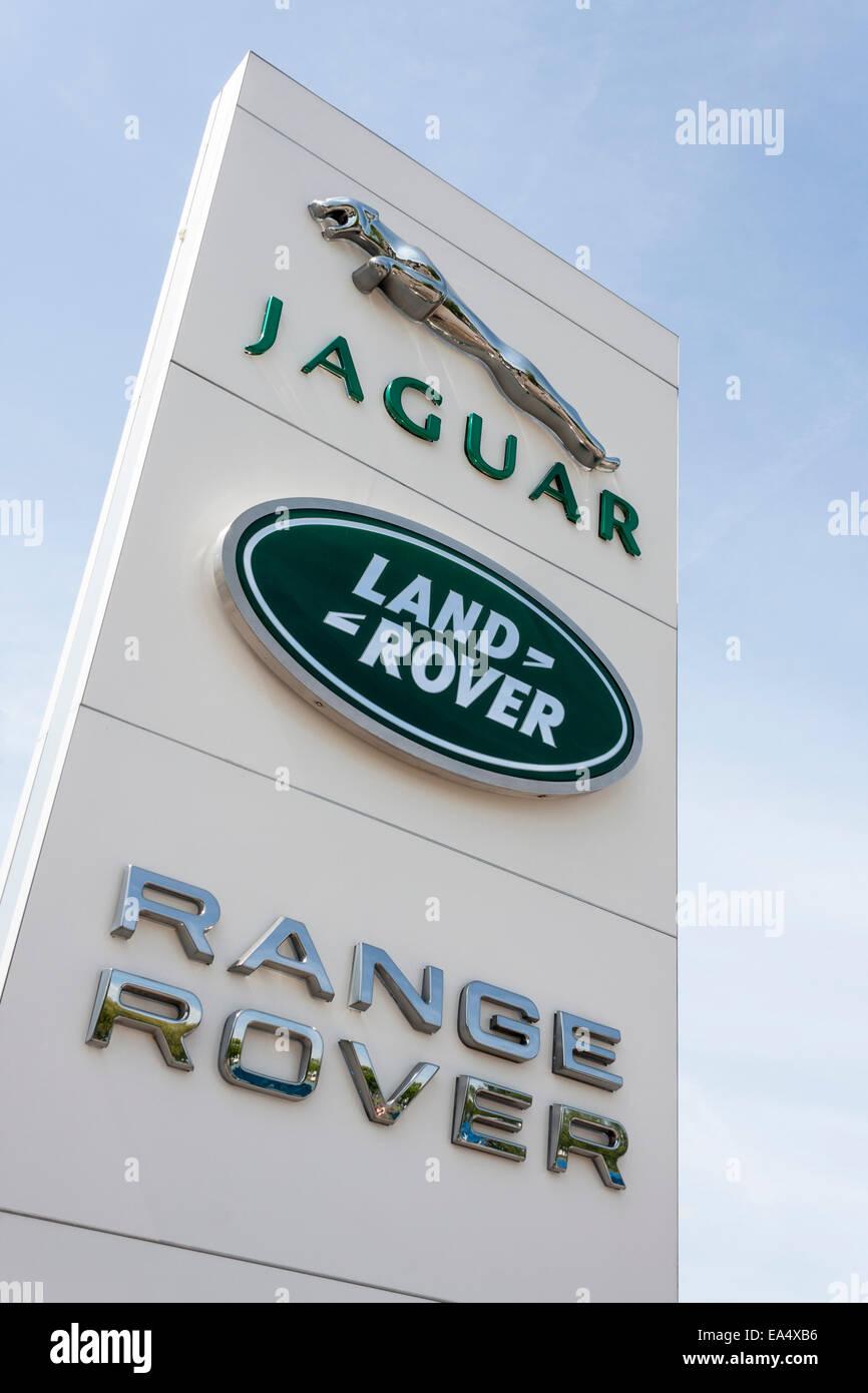 Jaguar, Land Rover, Range Rover sign outside a car dealership. - Stock Image