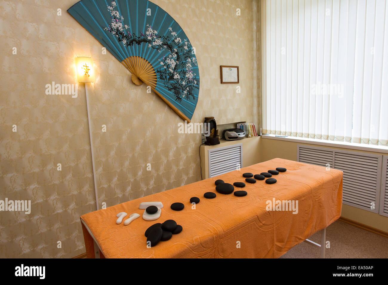 Massage table, stone therapy, spa salon - Stock Image