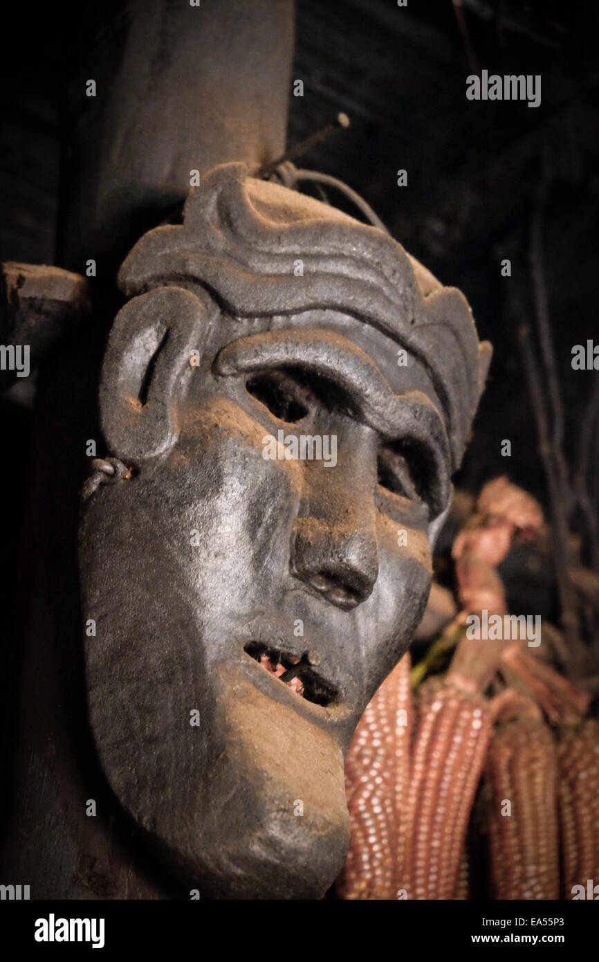 A mask made of wood functioned as a decoration inside traditional house of Mollo people, West Timor, Indonesia. - Stock Image