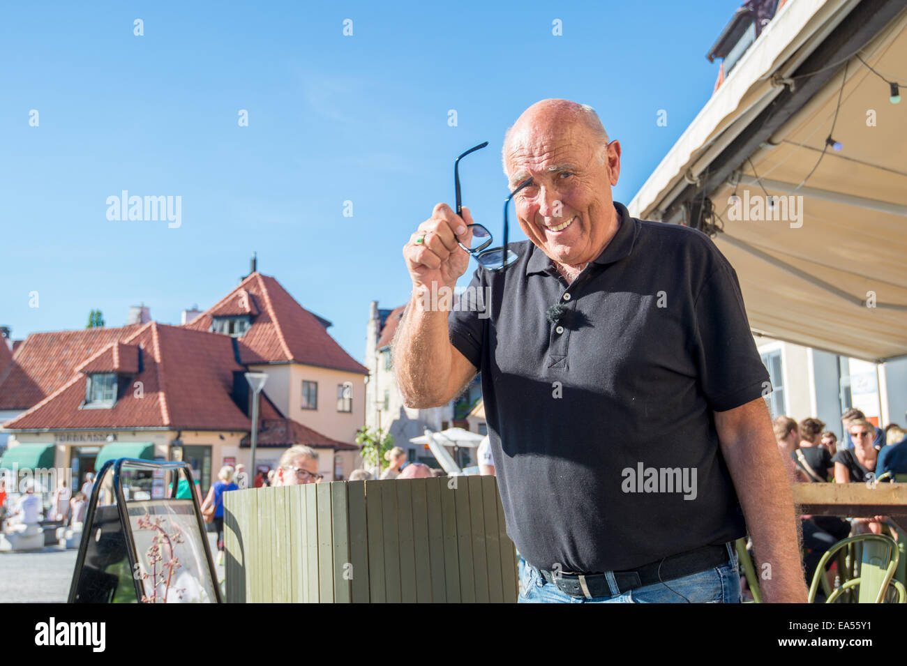 Ingvar Oldsberg after recording a TV show in medieval Visby, Sweden. - Stock Image