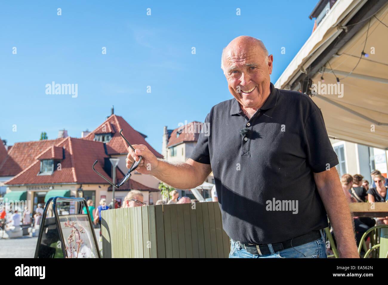 Ingvar Oldsberg after recording a TV show in medieval Visby, Sweden. - Stock Image