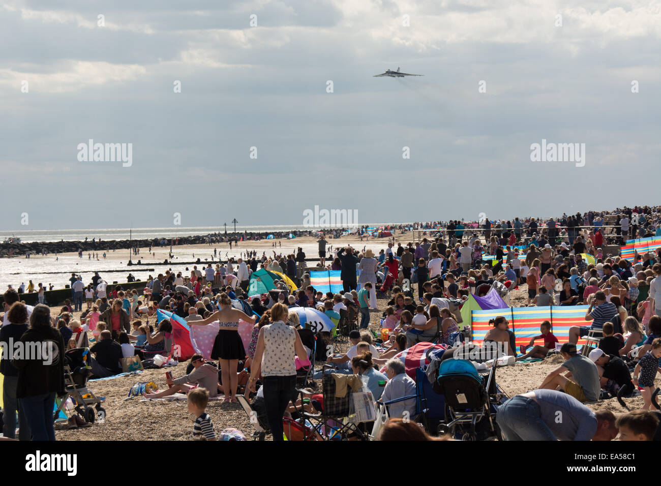 The last flying Avro Vulcan starts it flight past the crowds at Clacton-on-Sea Airshow, Essex. The airshow attracts - Stock Image