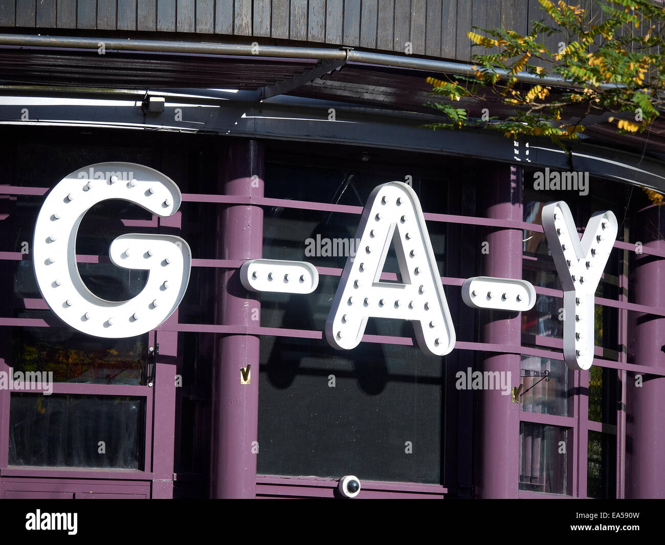 Gay bar sign on Canal Street in Manchester UK - Stock Image