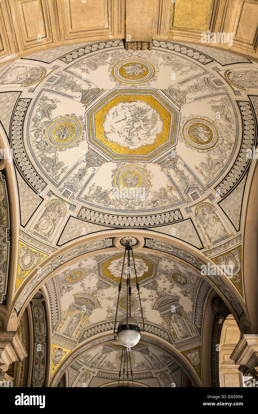 Ornately decorated ceiling inside the main entrance of Hungarian State Opera House in Budapest, Hungary. - Stock Image