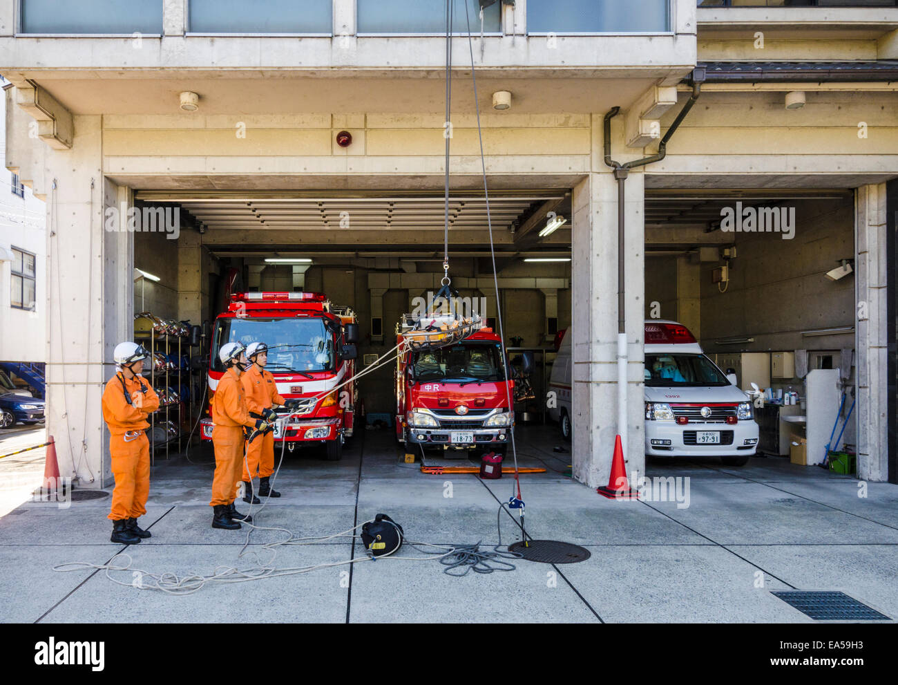 Kyoto Firemen training outside their fire station, Kyoto Japan - Stock Image