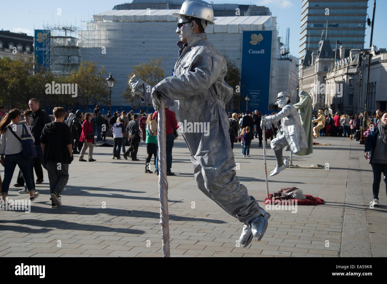 Trafalgar square. Mime artists appear to be suspended in mid air. Stock Photo