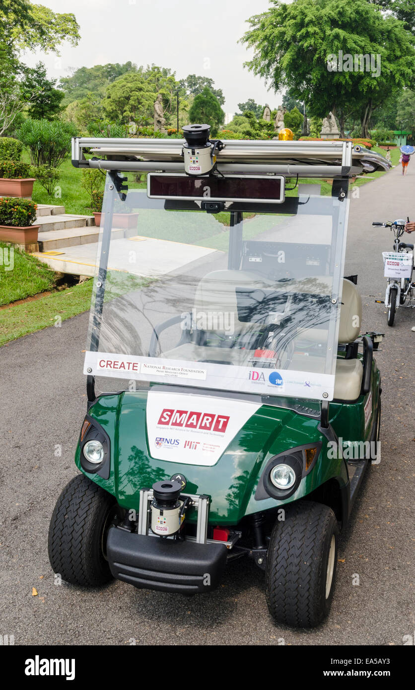 Driverless car, a converted golf buggy is being used as a driver-less car test vehicle in Singapore's Chinese - Stock Image