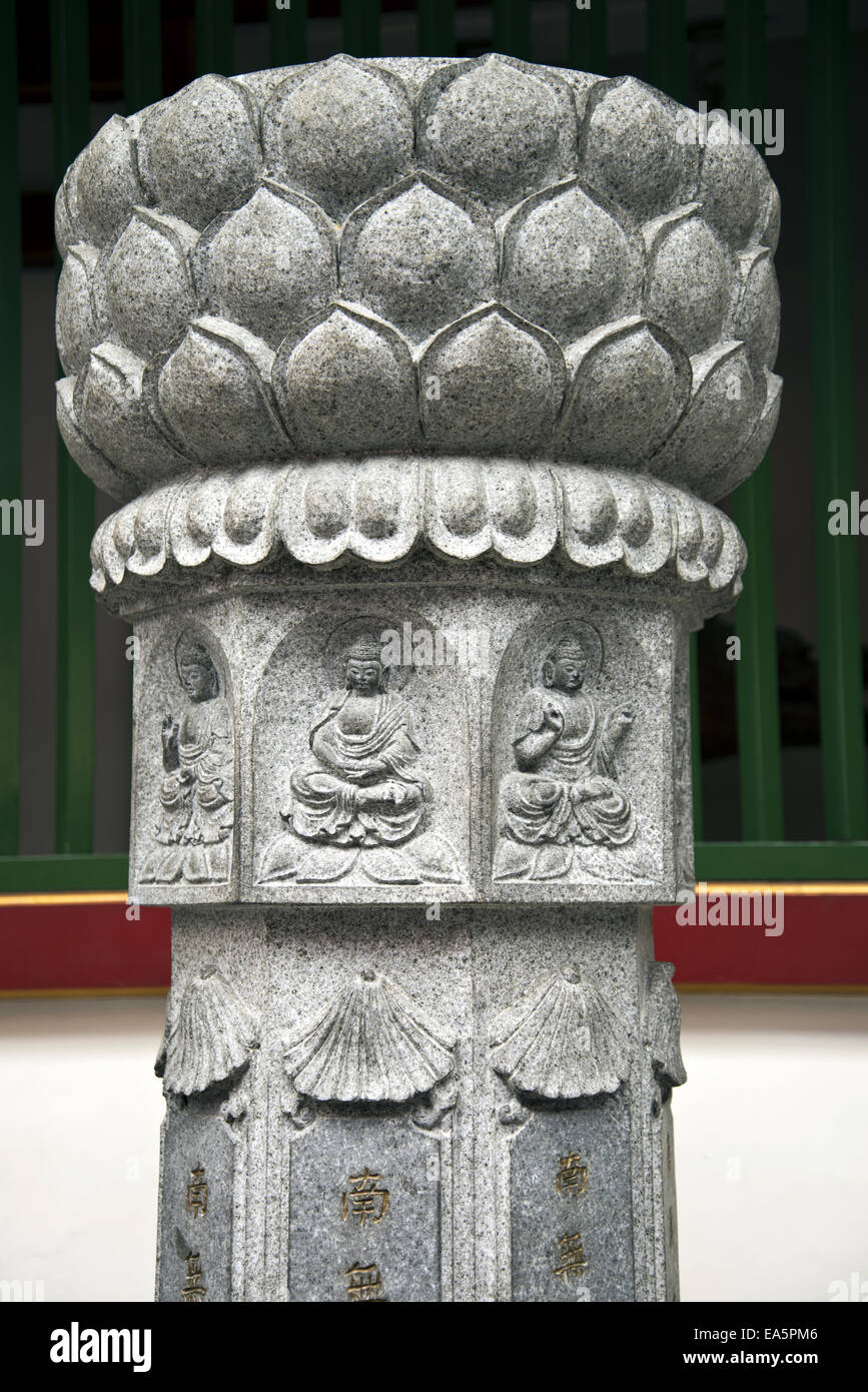 Sculpture with buddhist symbolism - Stock Image