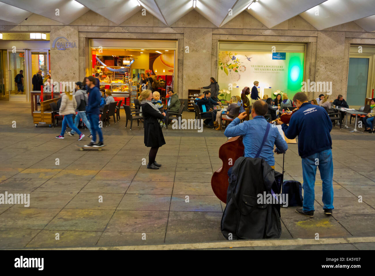 Buskers playing classical music, Alexanderplatz, Mitte district, Berlin, Germany - Stock Image