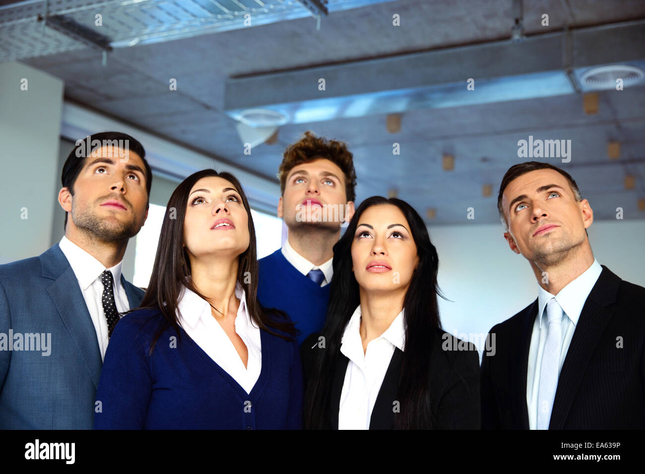 Business people looking up with dreaming expression Stock Photo