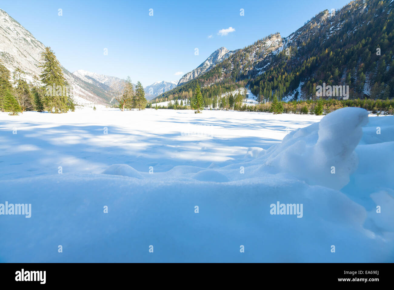 Snow fall early winter and late autumn. Alps landscape with snow capped mountains in the late autumn season. - Stock Image