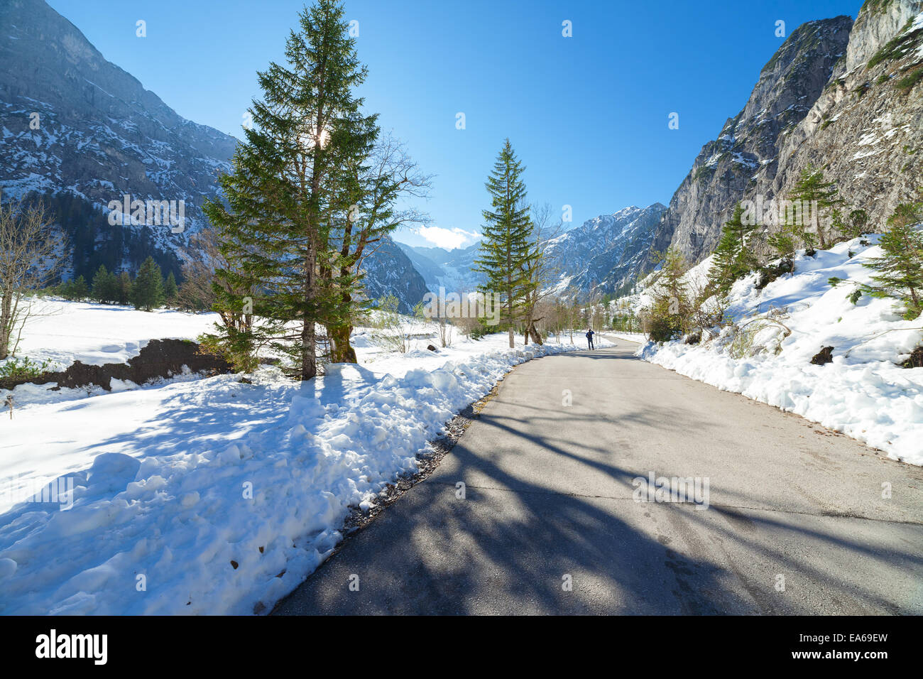 Snow fall early winter and late autumn. Winter road in the forest. - Stock Image