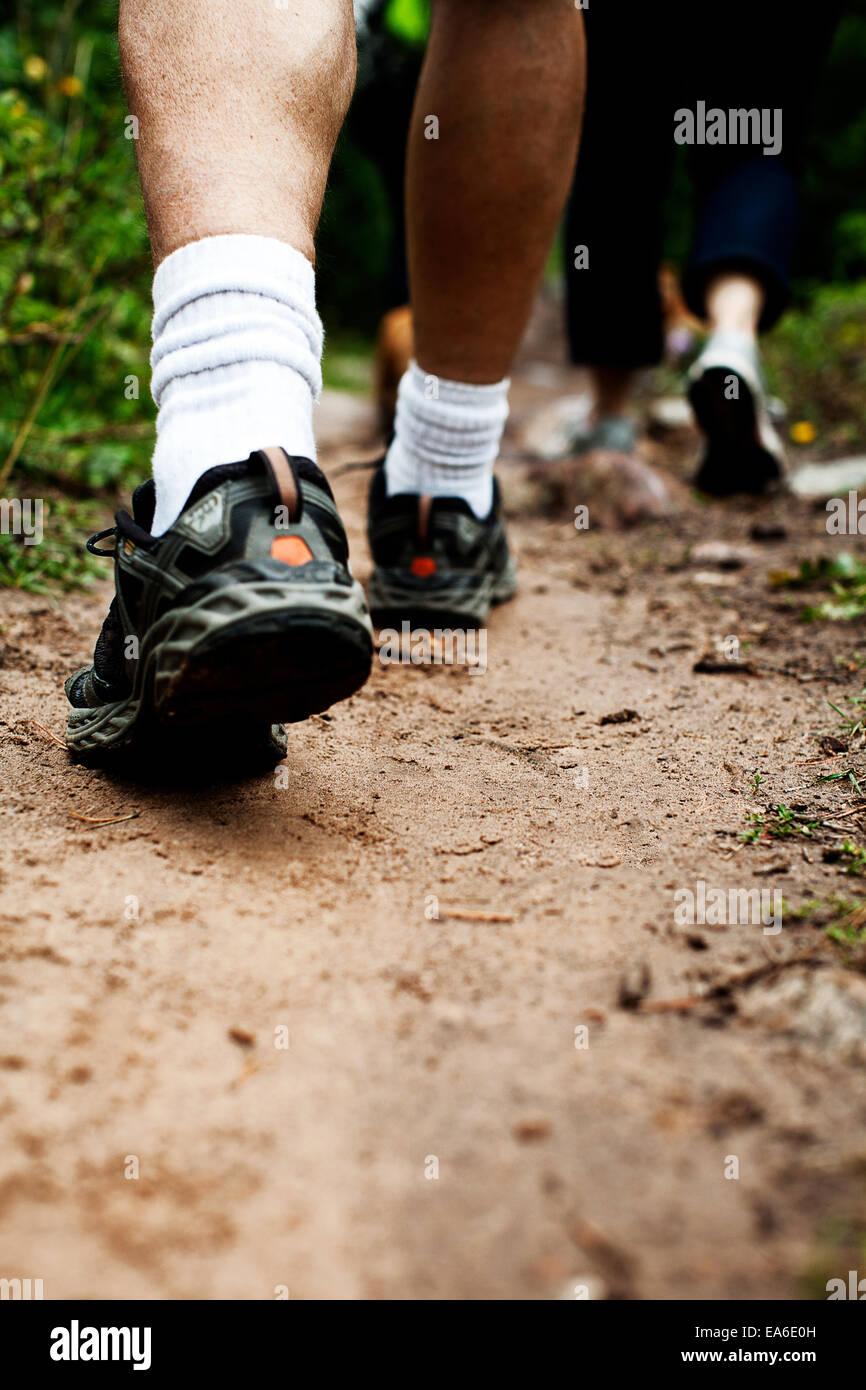 USA, Utah, Friends walking dirt road - Stock Image