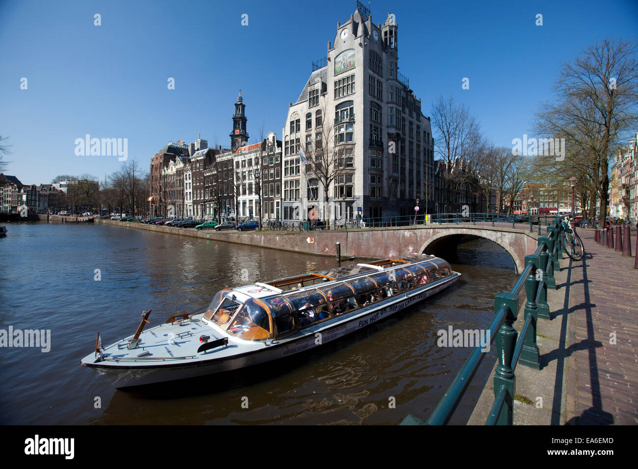 Netherlands, Amsterdam, Tour boat on canal - Stock Image