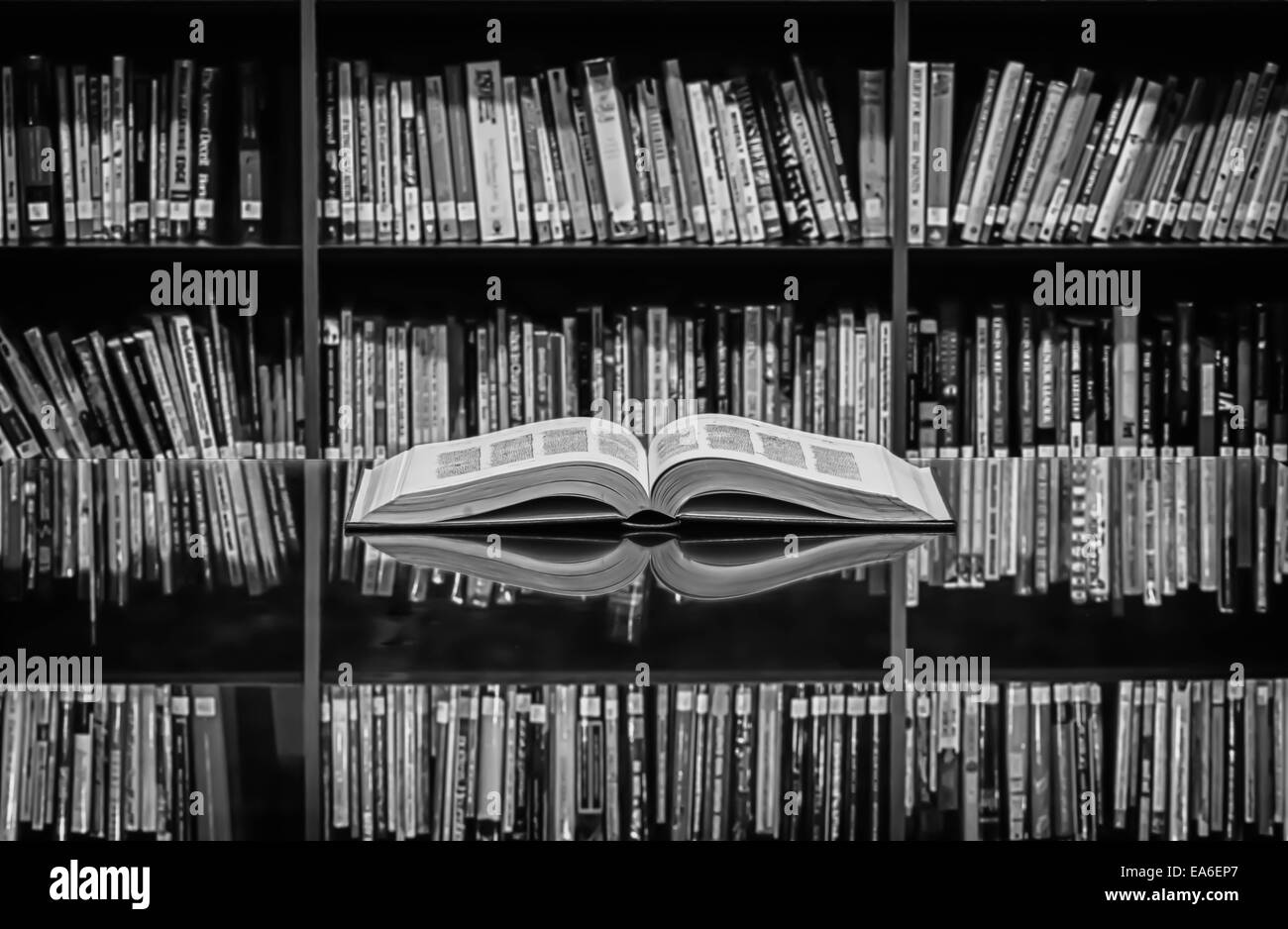 An open book on library desk - Stock Image