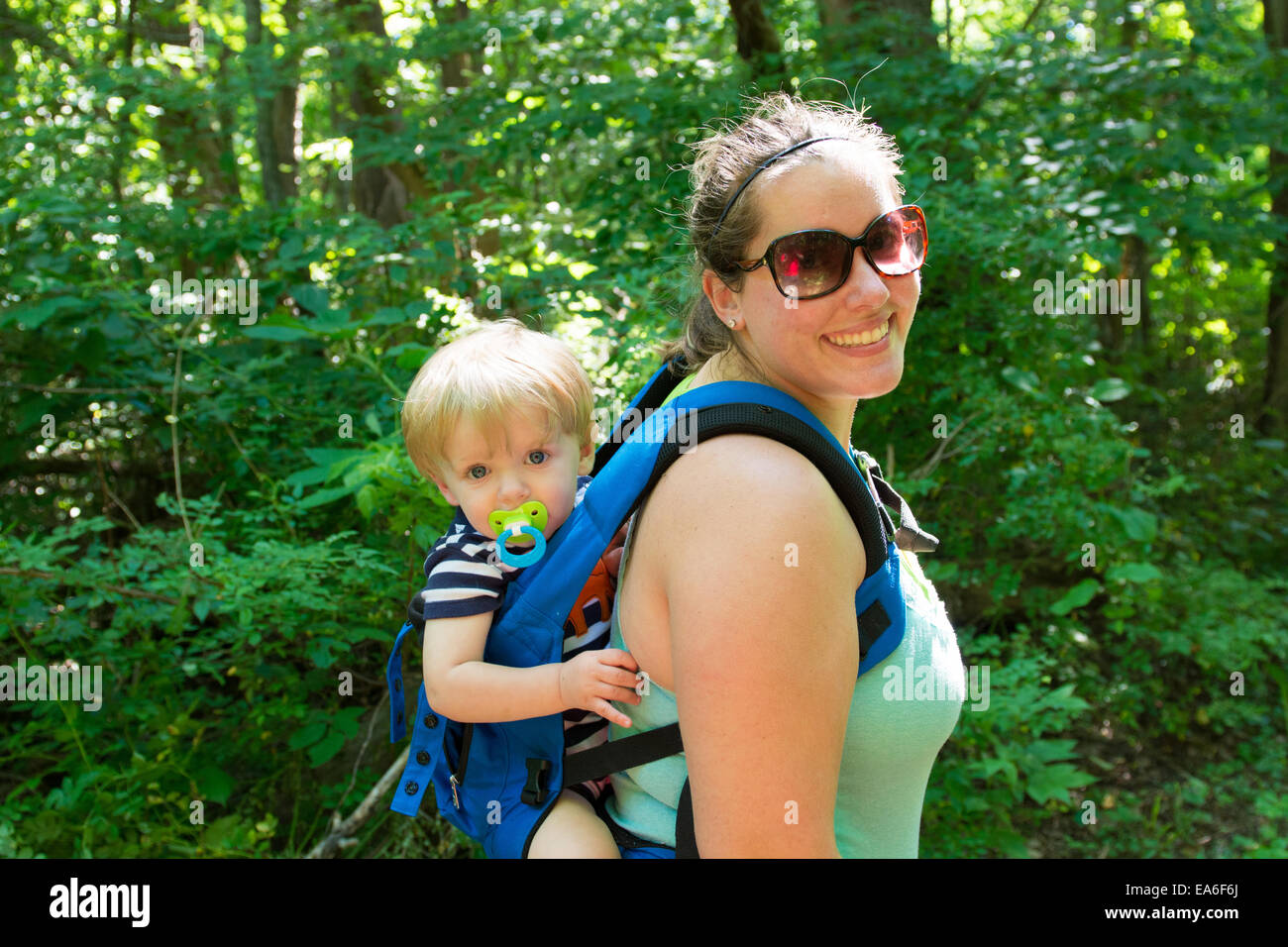 USA, Indiana, Mother and son hiking in woods - Stock Image