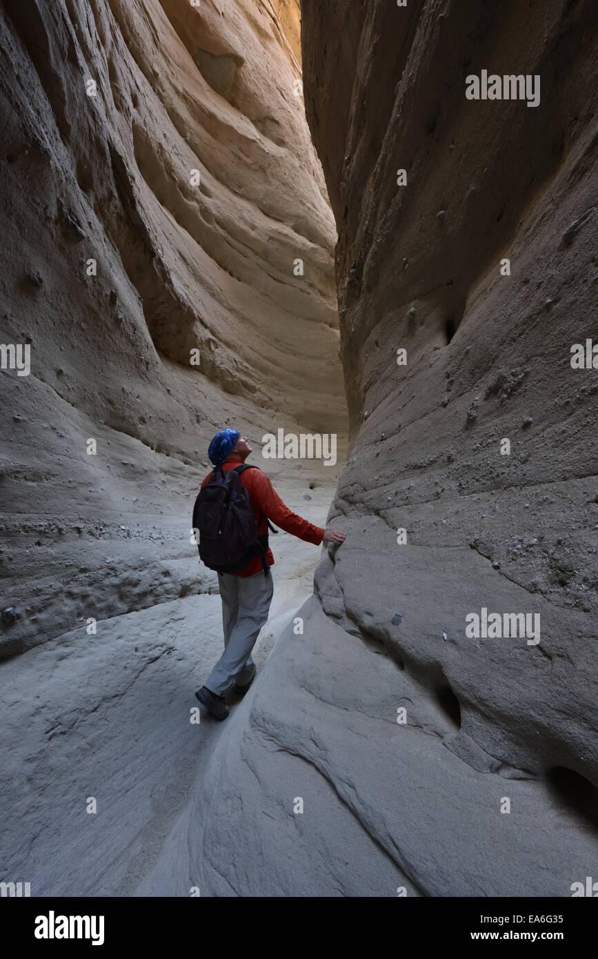 USA, California, Anza-Borrego Desert State Park, Man hiking through Palm Slot Canyon - Stock Image