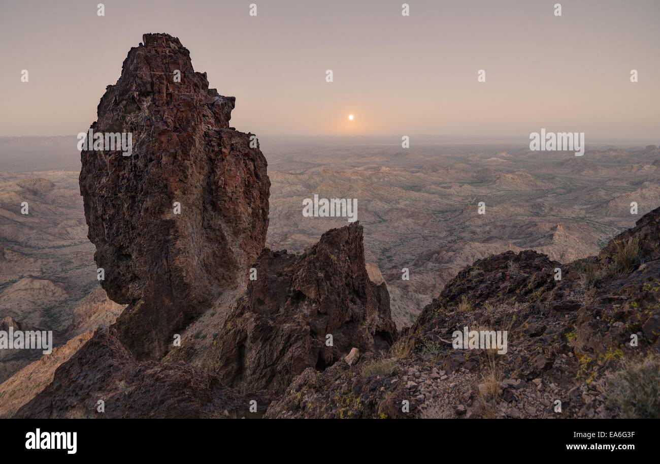 USA, Arizona, Kofa National Wildlife Refuge, Full Moon Rising from Castle Dome - Stock Image
