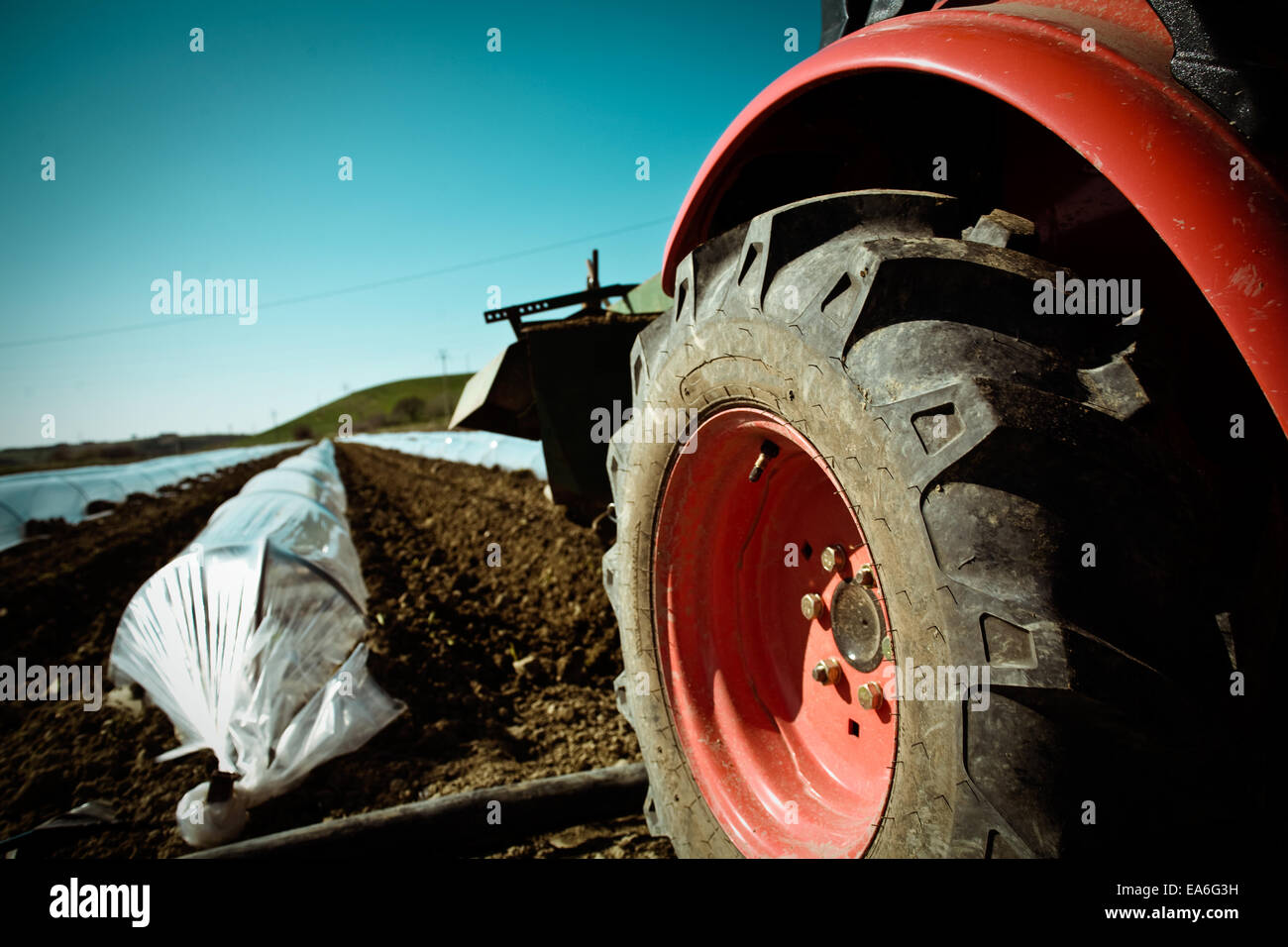 Tractor on cultivated ground - Stock Image
