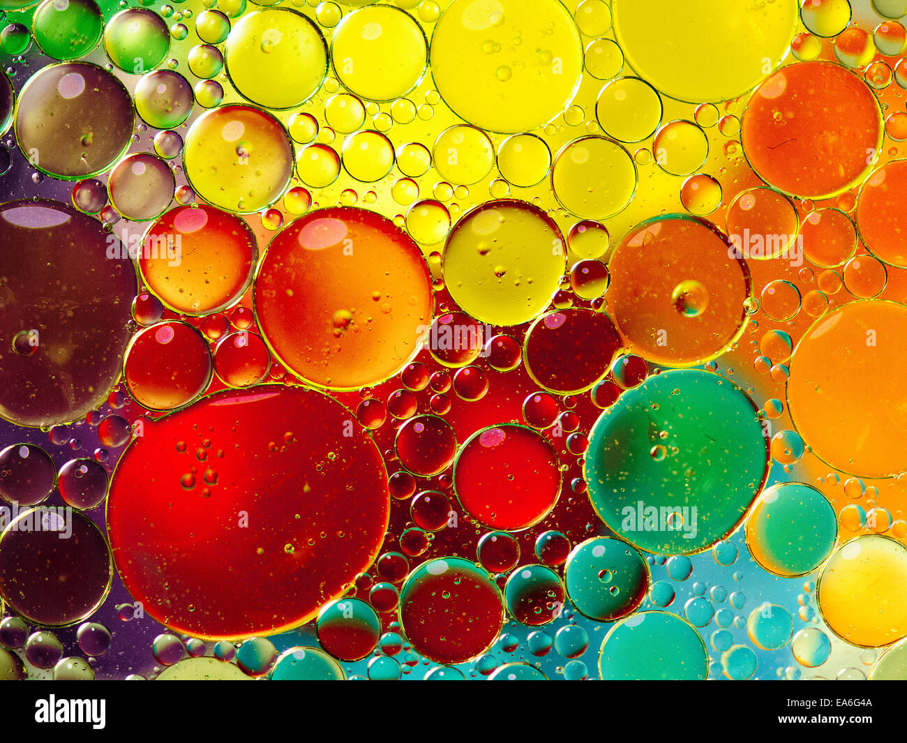 Oil bubbles in water - Stock Image