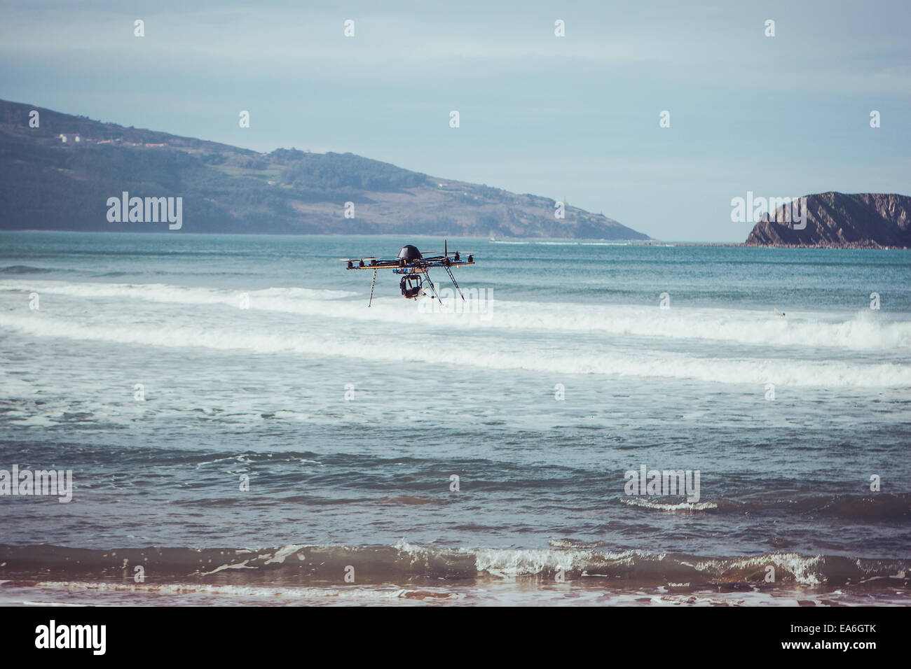 Drone flying over sea, Bermeo, Spain - Stock Image