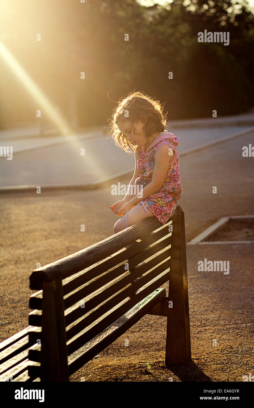 Outstanding Girl Sitting On The Back Of A Wooden Bench Stock Photo Ocoug Best Dining Table And Chair Ideas Images Ocougorg