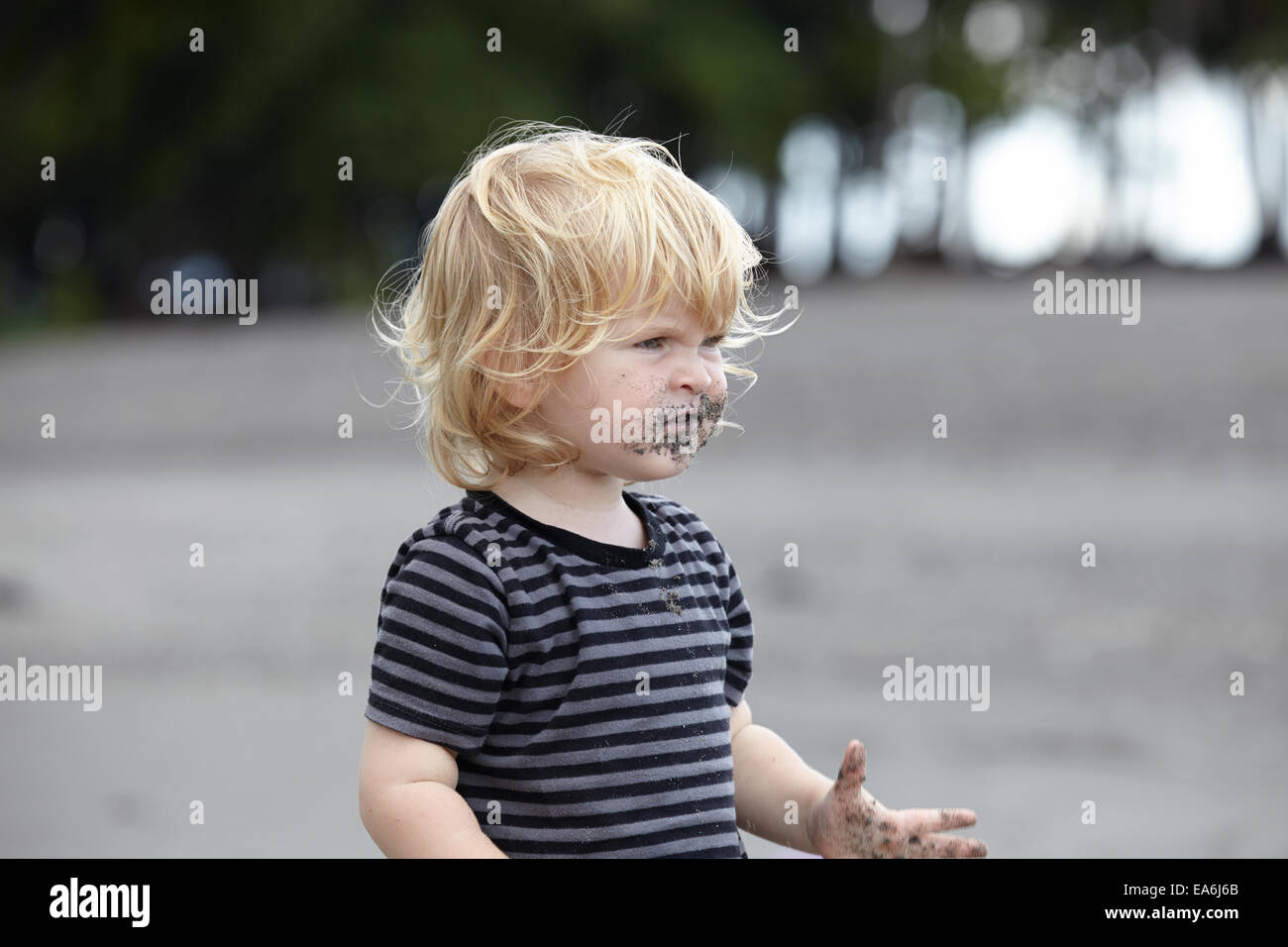 Toddler (18-23 months) playing with sand - Stock Image