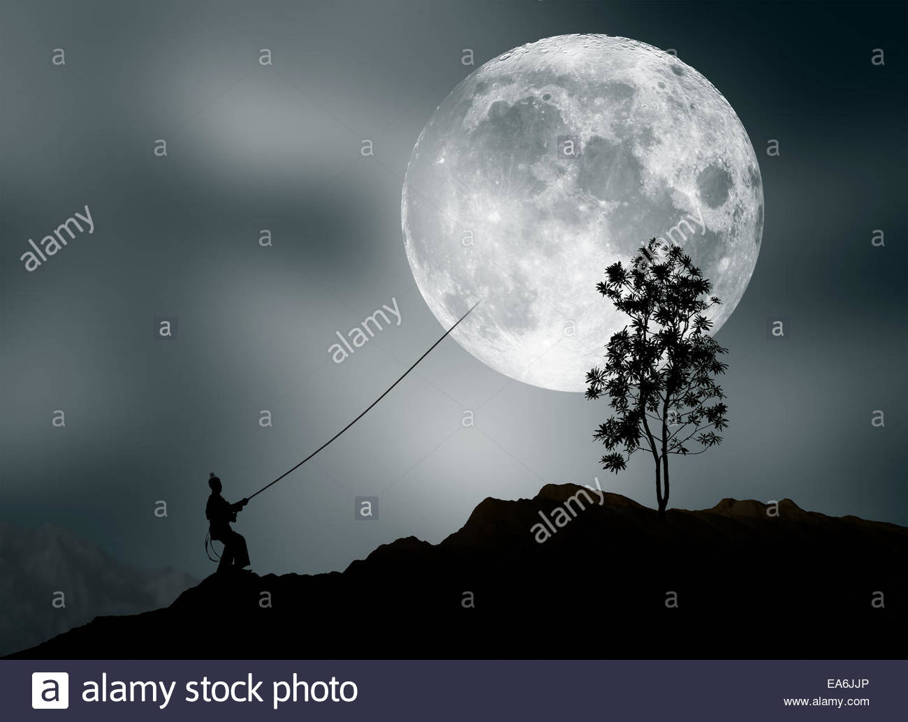 Man pretending to steal moon - Stock Image