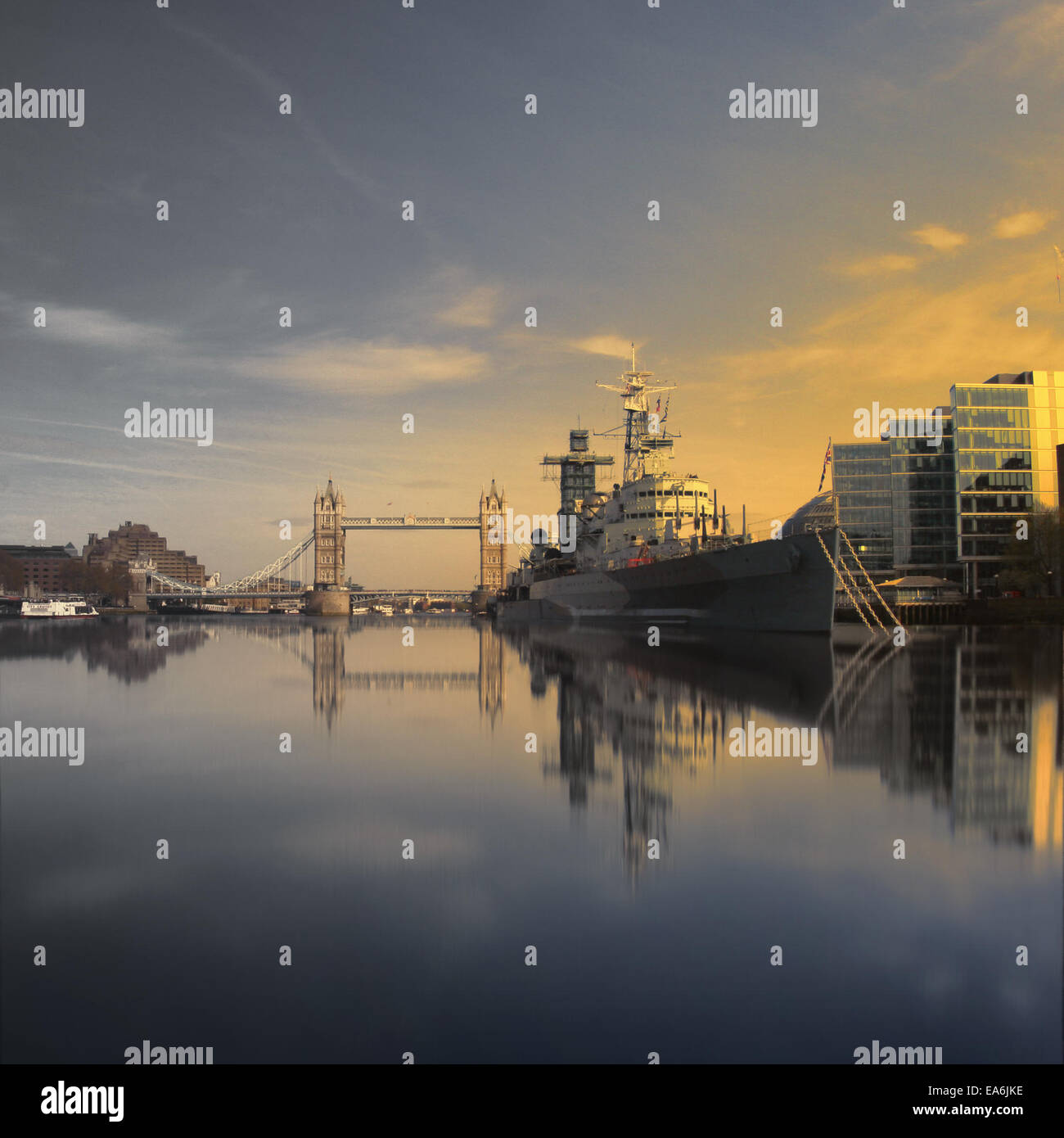 UK, London, HMS Belfast and Tower Bridge seen from water line - Stock Image