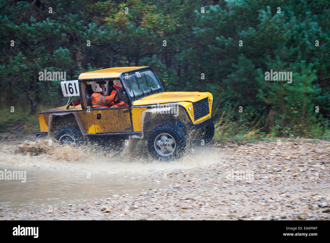 Competitive Safari Off Road racing event at Bagshot, Surrey in October - Stock Image