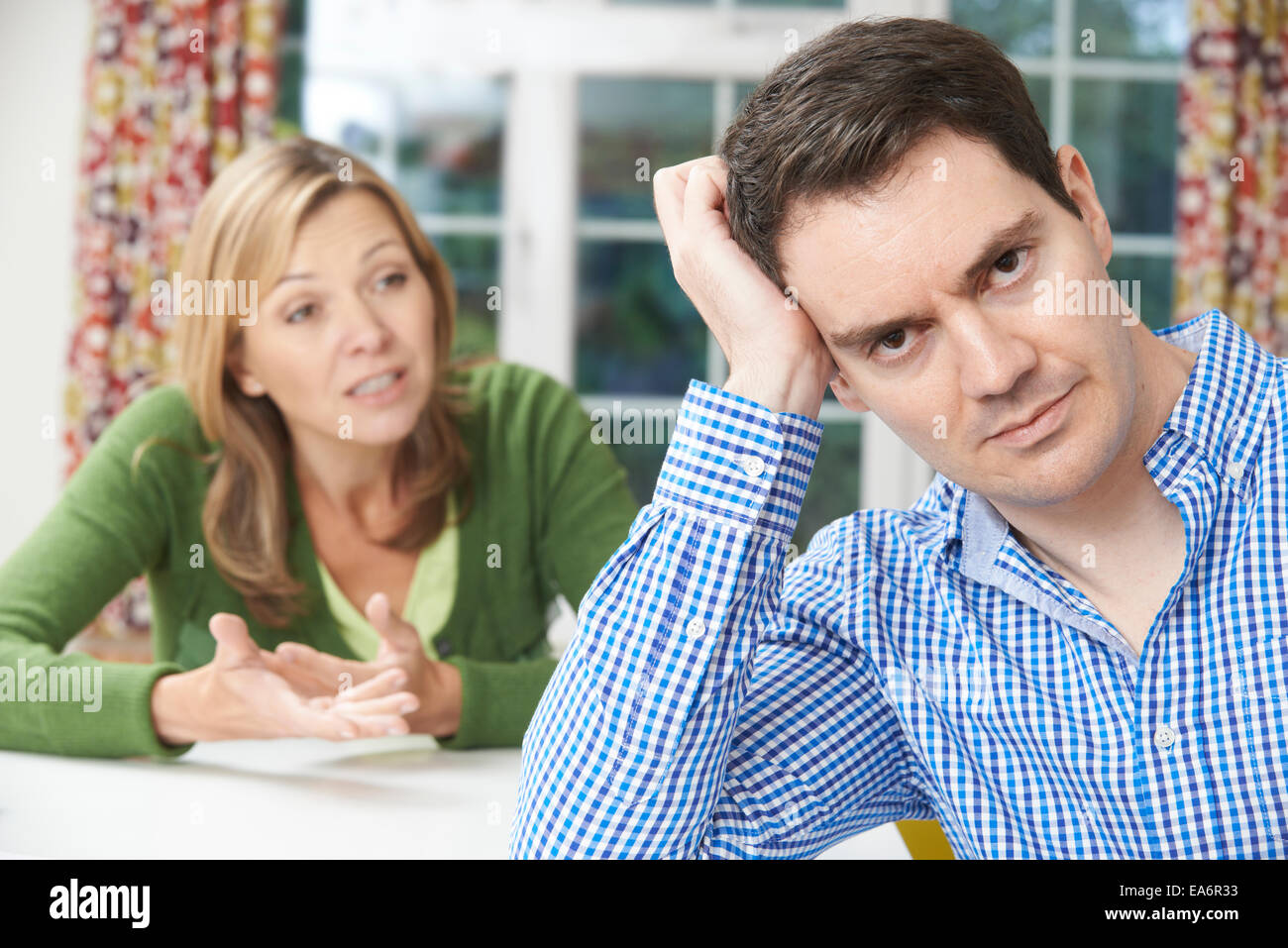 Couple Having Argument At Home - Stock Image