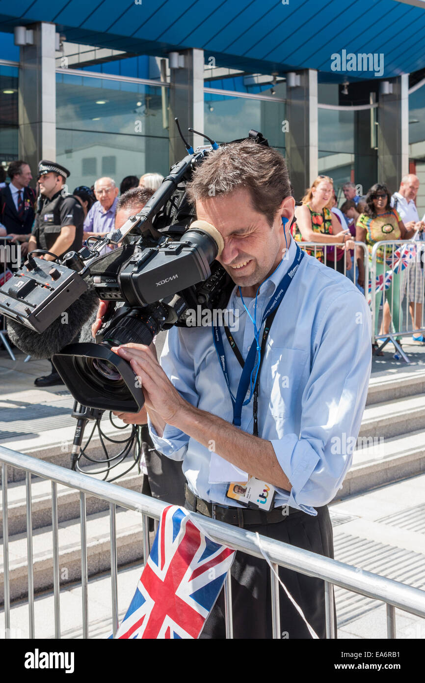 Video cameraman filming at a Royal event - Stock Image
