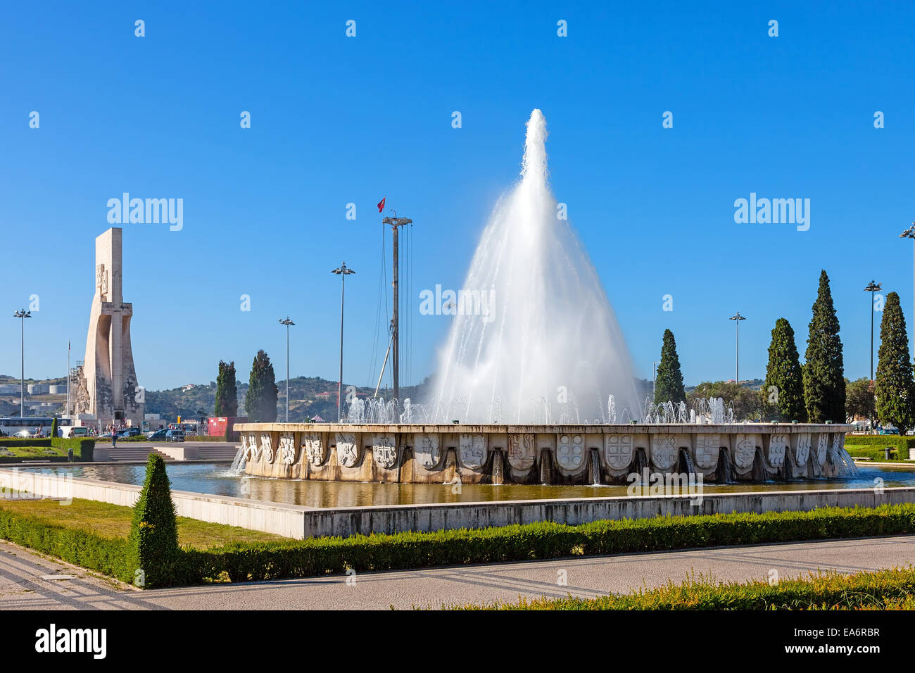Fountain in the Imperio garden with Padrao dos Descobrimentos (left) in Lisbon, Portugal. - Stock Image