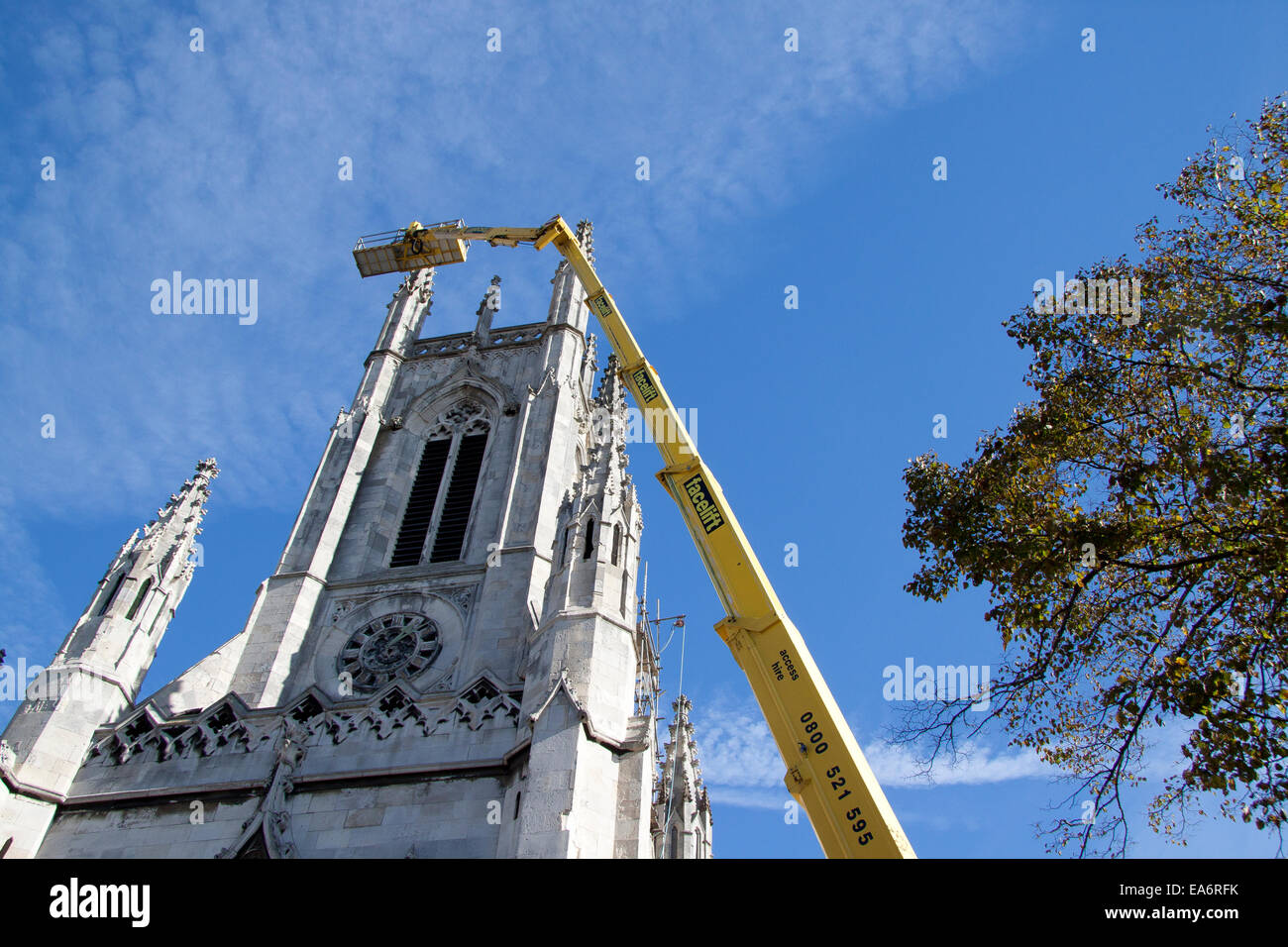 A tall cherry picker and access platform from Facelift servicing St Peters church tower, Brighton Stock Photo