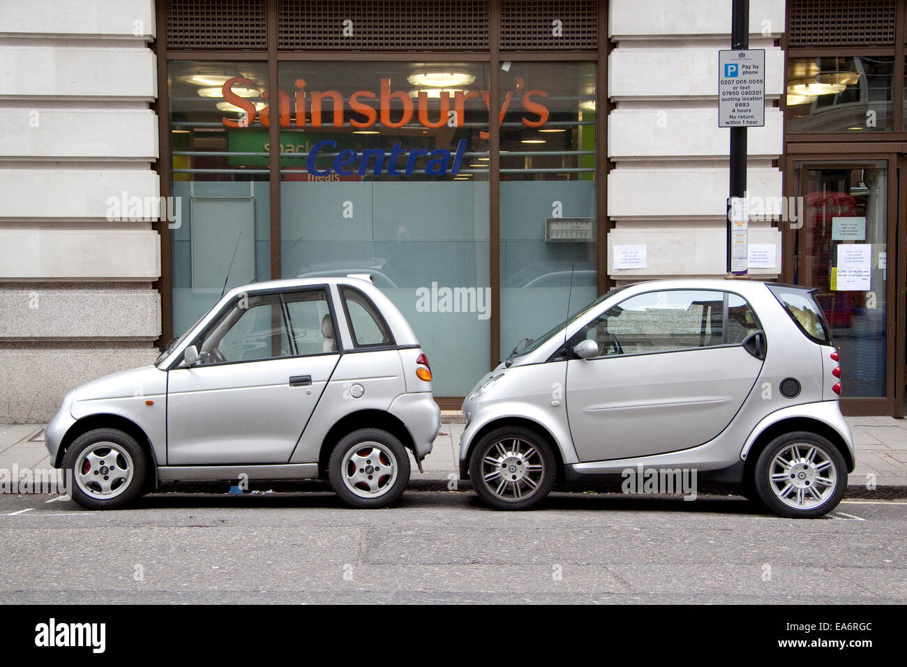 Two small cars, one electric and one petrol from different Stock ...