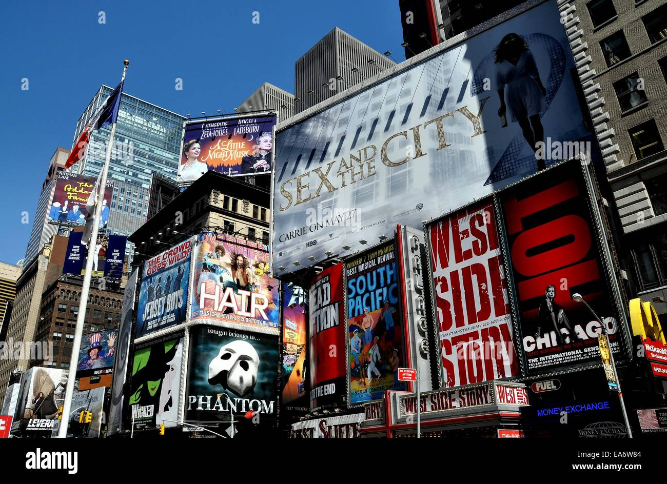 NYC:  Advertising covers the sides of buildings promoting Broadway musicals and films in Times Square at West 46th - Stock Image