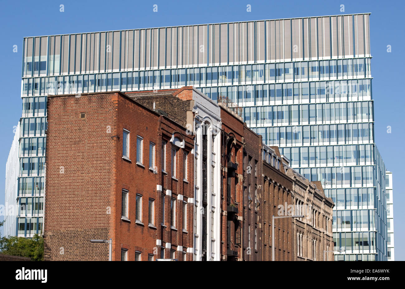 Contrasting architecture of the old and new with the Bankside development on Southwark Street, London - Stock Image