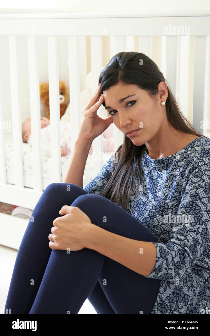 Frustrated Mother Suffering From Post Natal Depression Stock Photo