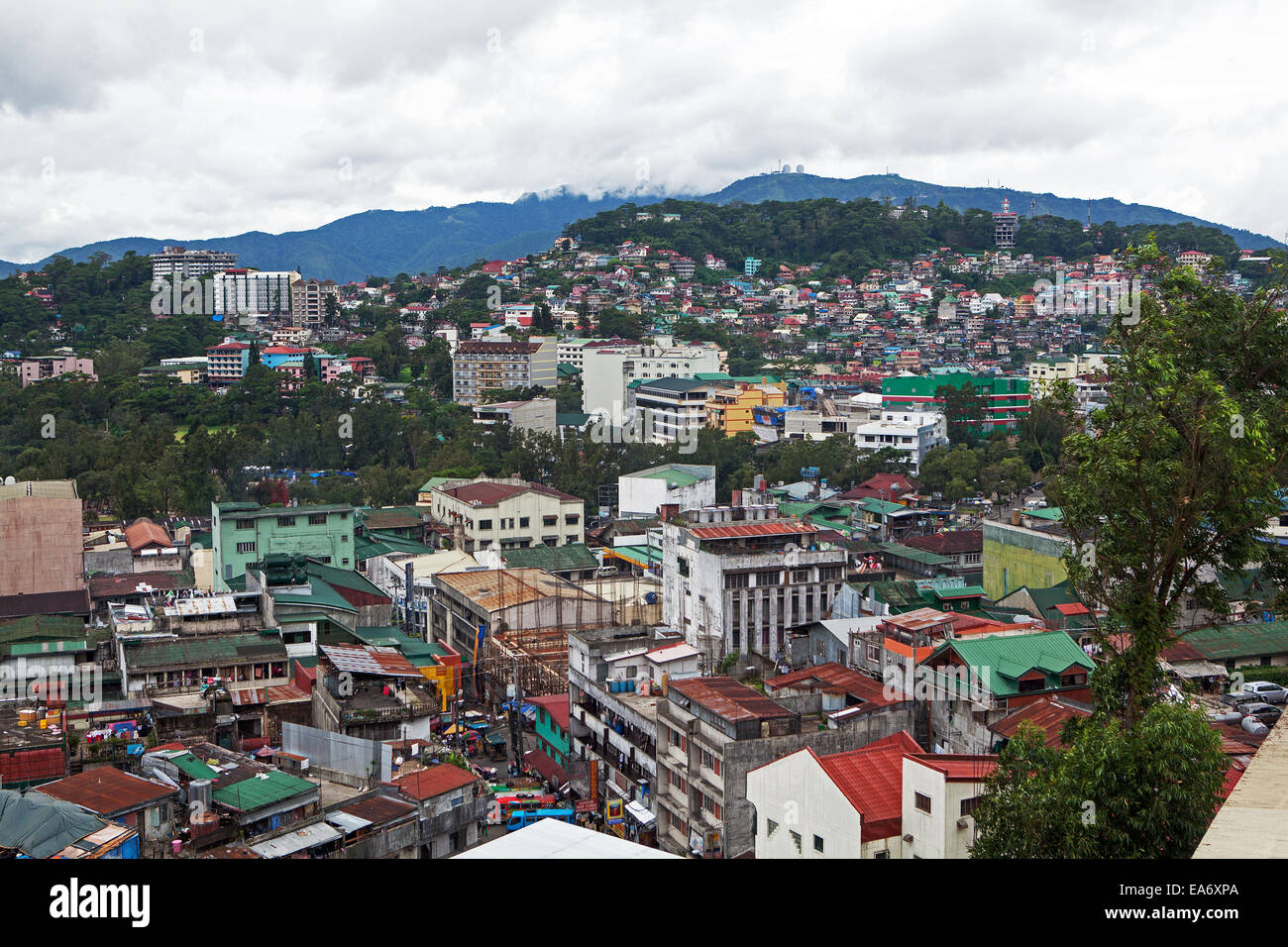 Overpopulated living conditions in Baguio City, Philippine Islands. Commercial building and homes compete for space. - Stock Image