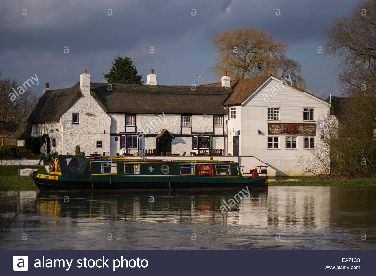 Narrow boat moored outside the Ferry Boat Inn on the River Great Ouse at Needingworth - Stock Image