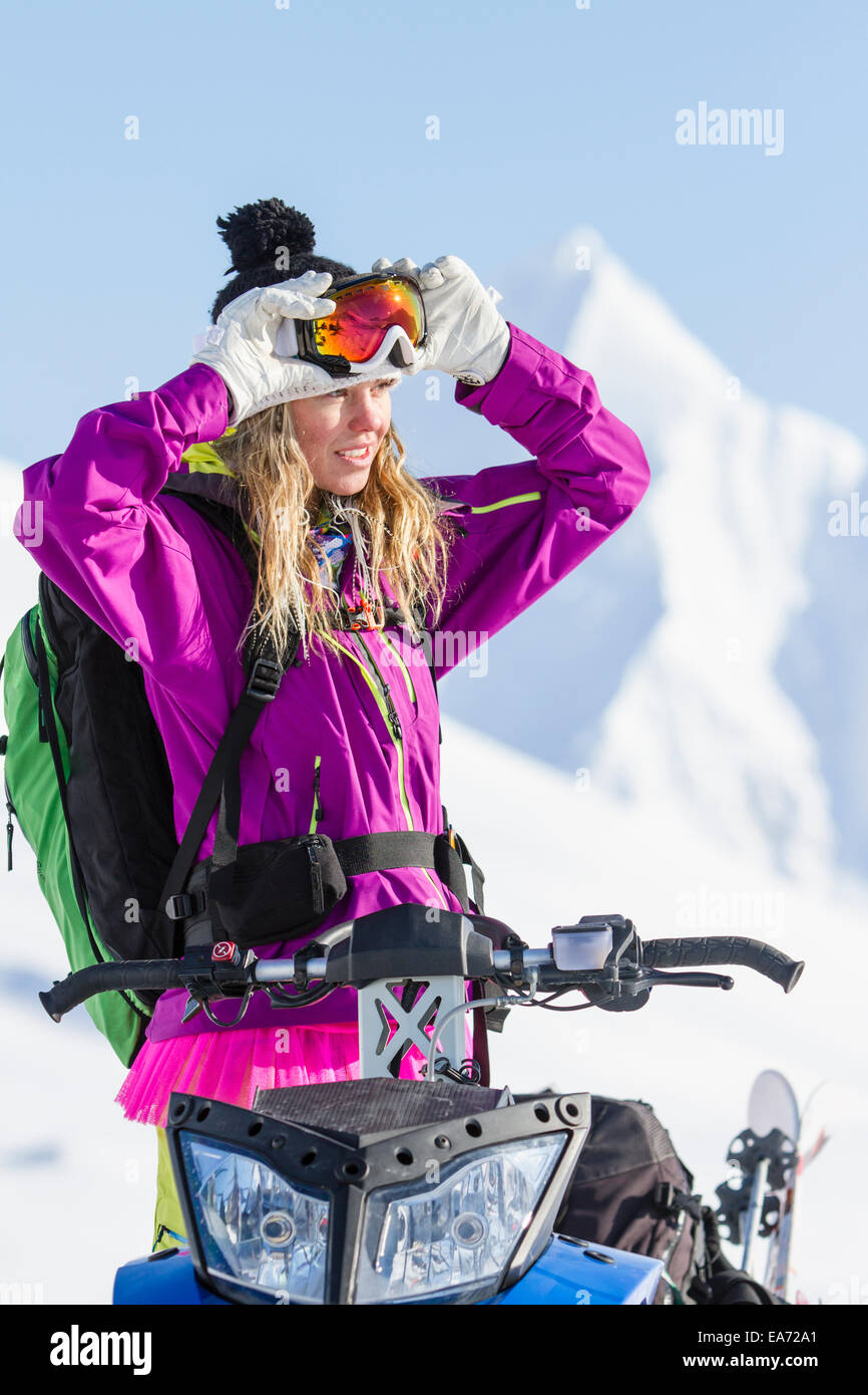 Lynsey Dyer In The Chugach Mountains For Some Backcountry Skiing By Snowmobile, Late Winter, Southcentral Alaska. - Stock Image