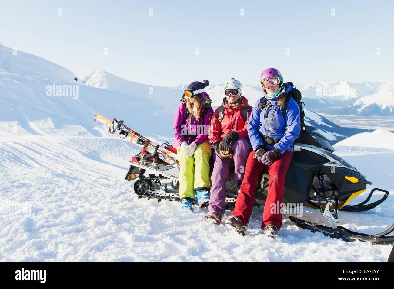 Women,Snowmobile,Alaska,Snow,Mountain - Stock Image