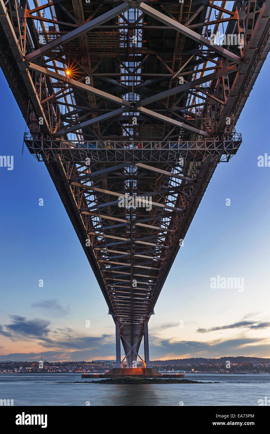 The Forth Road Bridge from below as seen from North Queensferry, Scotland not long after sunset - Stock Image
