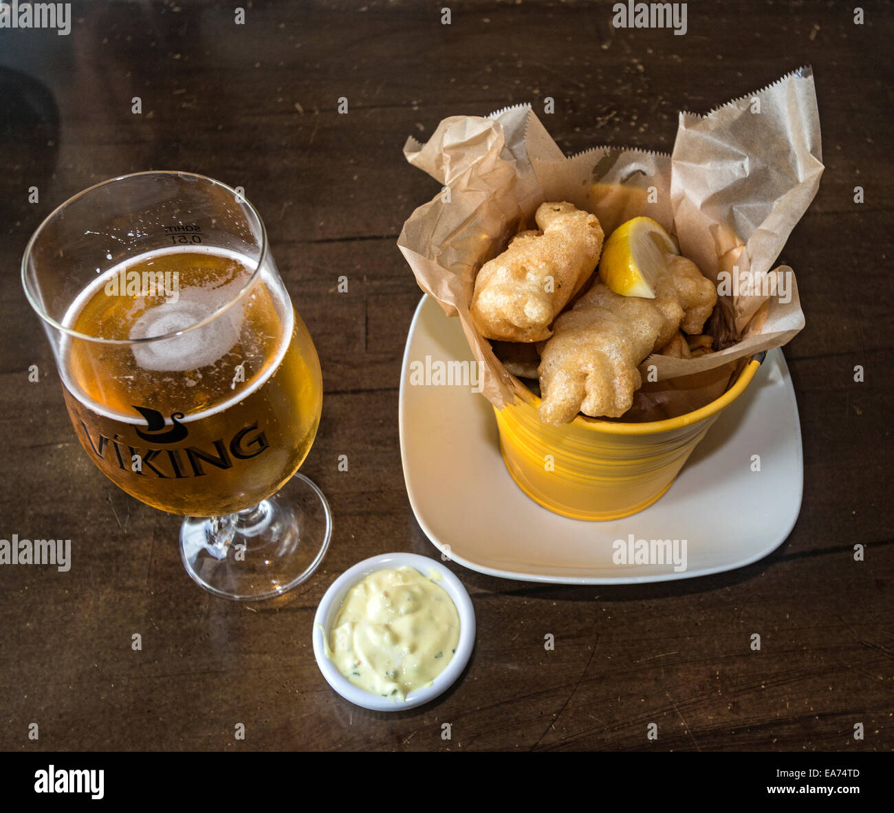 Fish & chips and beer at a local restaurant in Reykjavik, Iceland. - Stock Image