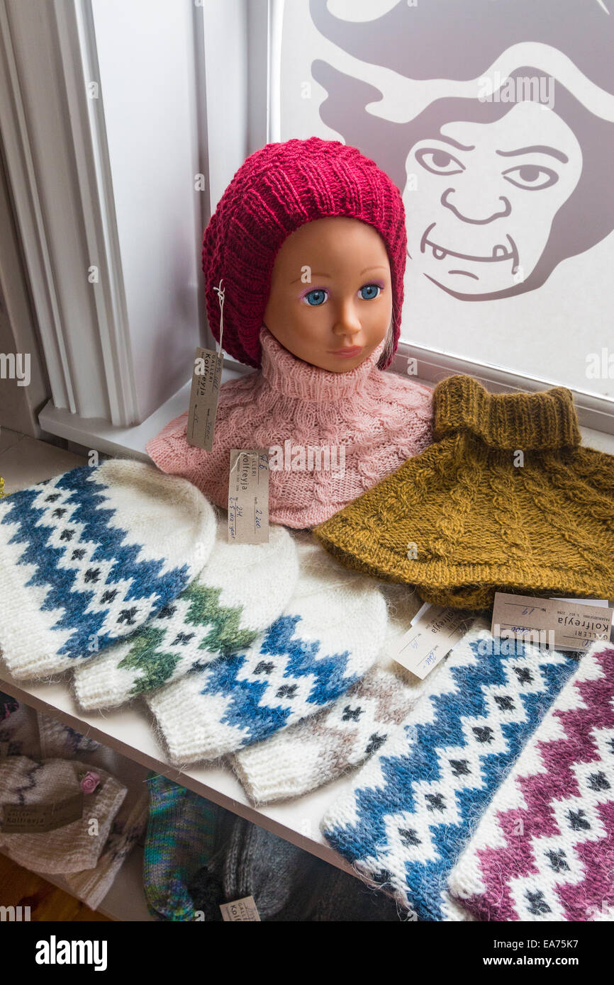 Wool knitted crafts made from local sheep in gift shop along the water in the eastern town of Faskrudsfjordur. - Stock Image